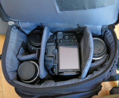 Here's the camera backpack loaded up. It fits the camera with attached lens and the three other lenses all in the padded bottom compartment leaving the top zippered area empty to store your lunch or whatever.